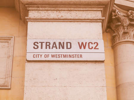 westminster city: LONDON, ENGLAND, UK - OCTOBER 23: The Strand street sign in the City of Westminster on October 23, 2013 in London, England, UK vintage Editorial