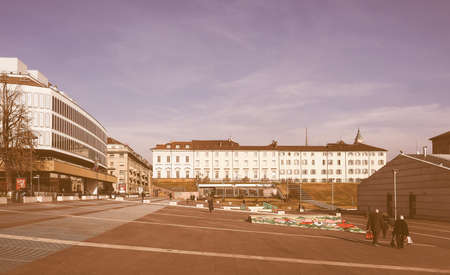 biergarten: TURIN, ITALY - DECEMBER 16, 2015: Piazzale Valdo Fusi square with a jazz club, a beer garden, the Museum of Natural History, the Chamber of Commerce vintage