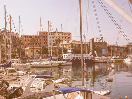 merchant: GENOA, ITALY - MARCH 16, 2014: Since the construction of the new harbour for merchant ships, the old harbour called Porto Vecchio is still in use for cruise ships and small boats vintage