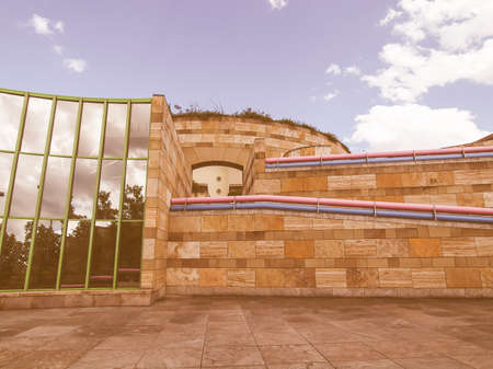 sir: STUTTGART, GERMANY - JULY 11, 2012: The Neue Staatsgalerie art gallery is a masterpiece of postmodern architecture designed by British architect Sir James Stirling in 1977 vintage