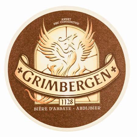 belgien: BRUSSELS, BELGIUM - MARCH 15, 2015: Beermat of Belgian beer Grimbergen isolated over white background vintage