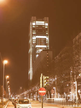 at the highest: TURIN, ITALY - FEBRUARY 26, 2015: Night view of the new San Paolo skyscraper designed by Renzo Piano which is the highest building in town vintage Editorial