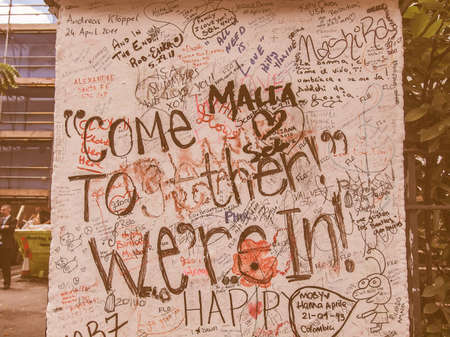 18 month old: LONDON, ENGLAND, UK - JUNE 18, 2011: Graffiti by Beatles fans on the wall of the Abbey Road studios where the homonymous album was recorded in 1969 vintage
