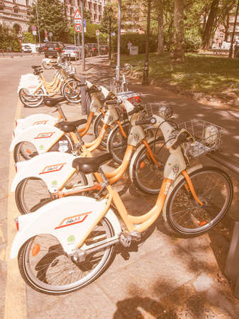 docking: MILAN, ITALY - APRIL 10, 2014: A docking station for the cycle hire network vintage