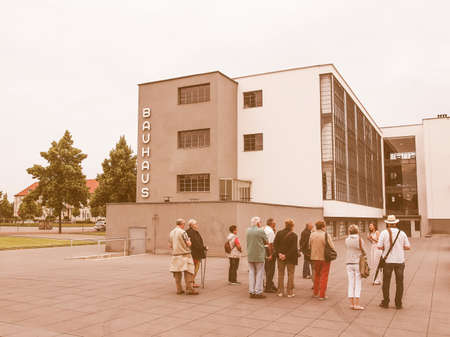 bauhaus: DESSAU, GERMANY - JUNE 13, 2014: Visitors on an official guided tour of the Bauhaus building vintage