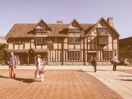 william shakespeare: STRATFORD UPON AVON, UK - SEPTEMBER 26, 2015: Tourists in front of William Shakespeare birthplace vintage