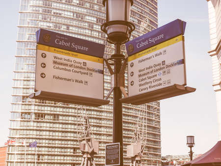 docklands: LONDON, UK - JUNE 11, 2015: Direction sign in Cabot Square in London Docklands at Canary Wharf vintage