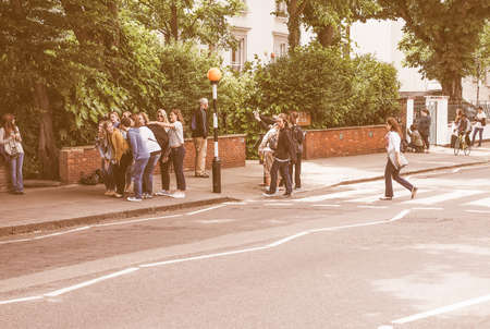album cover: LONDON, UK - JUNE 10, 2015: Abbey Road zebra crossing made famous by the 1969 Beatles album cover vintage Editorial