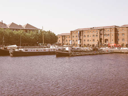 english west country: LONDON, UK - JUNE 11, 2015: West India Quay in Docklands vintage