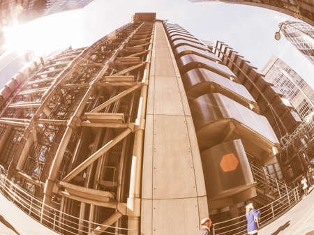 richard: LONDON, UK - SEPTEMBER 29, 2015: Lloyd of London is an iconic high tech skyscraper designed by architect Richard Rogers seen with fisheye lens vintage Editorial