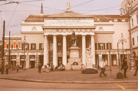 felice: GENOA, ITALY - MARCH 16, 2014: Tourists in front of Teatro Carlo Felice opera house designed by architect Aldo Rossi in 1991 following the destruction of the old theatre by fire vintage