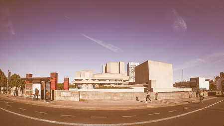 sir: LONDON, UK - SEPTEMBER 28, 2015: The National Theatre designed by Sir Denys Lasdun is a masterpiece of new brutalist architecture seen with fisheye lens vintage