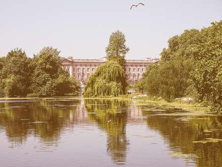 buckingham palace: LONDON, UK - JUNE 11, 2015: St James Park with Buckingham Palace in the background vintage