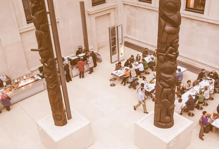 british people: LONDON, UK - CIRCA MARCH, 2008: People queueing at the British Museum cafeteria bar in the Great Court vintage