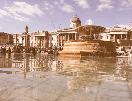 trafalgar: LONDON, UK - SEPTEMBER 27, 2015: Tourists in Trafalgar Square vintage