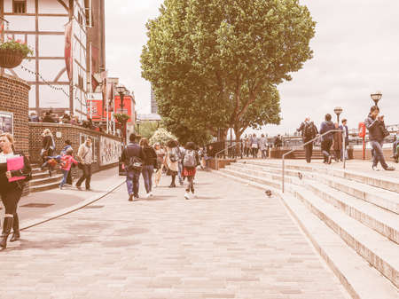 southbank: LONDON, UK - JUNE 10, 2015: People walking on the River Thames South Bank vintage Editorial