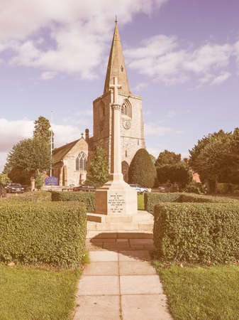 arden: TANWORTH IN ARDEN, UK - SEPTEMBER 25, 2015: The Village Green with St Mary Magdalene church and war memorial vintage