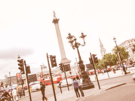 17 year old: LONDON, UK - JUNE 17, 2011: Pedestrians and buses in the busy Trafalgar Square in central London vintage