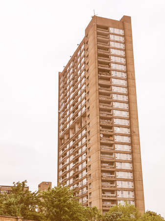 listed: LONDON, ENGLAND, UK - MAY 06, 2010: The Balfron Tower designed by Erno Goldfinger in 1963 is a Grade II listed masterpiece of new brutalist architecture vintage