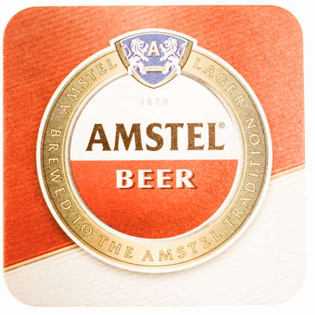 amstel: AMSTERDAM, NETHERLANDS - MARCH 15, 2015: Beermat of Dutch beer Amstel isolated over white background vintage