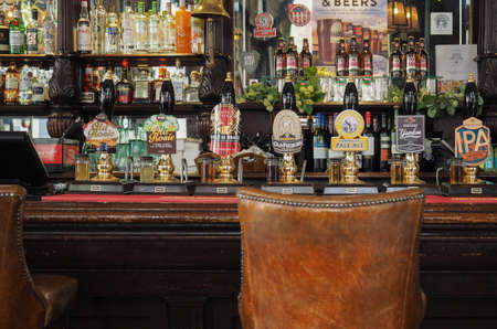 beers: LONDON, UK - CIRCA SEPTEMBER 2015: Draught cask beers in a traditional English Pub - frontal view