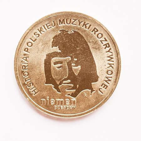 commemorating: WARSAW, POLAND - AUGUST 16, 2015: Polish 2 zloti coin commemorating musician Czeslaw Niemen Historia polskiej muzyki rozrywkowej meaning History of polish music vintage