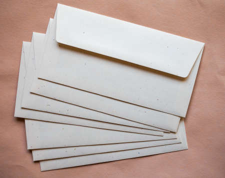 letter envelopes: Letter envelopes for mail postage over orange paper background Stock Photo