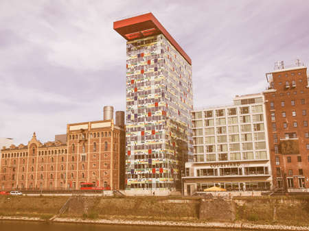 steven: DUESSELDORF, GERMANY - AUGUST 3, 2009: The new Medienafen is a redevelopment area in the former docklands and harbour with buildings designed by Steven Holl, David Chipperfield and Frank O Gehry vintage Editorial