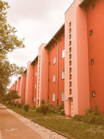 taut: BERLIN, GERMANY - MAY 11, 2014: The Hufeisensiedlung (meaning Horseshoe housing estate) aka Grosssiedlung Britz designed by Bruno Taut and Martin Wagner in 1925 is a masterpiece of early modernism vintage