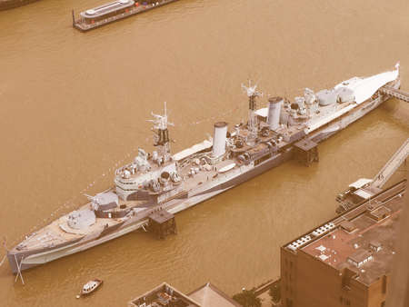 hms: LONDON, UK - JUNE 10, 2015: HMS Belfast ship originally a Royal Navy light cruiser is now permanently moored on the River Thames as a museum ship vintage Editorial