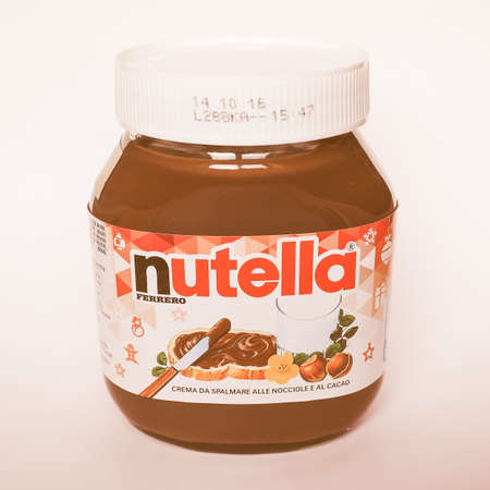nutella: ALBA, ITALY - CIRCA DECEMBER 2015: Jar of Italian Nutella hazelnuts cream made by Ferrero vintage