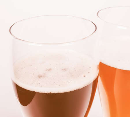 Vintage looking Two glasses of German dark and white weizen beer Stock Photo