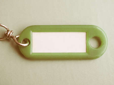 key ring: Green key ring with blank paper label with copy space vintage Stock Photo
