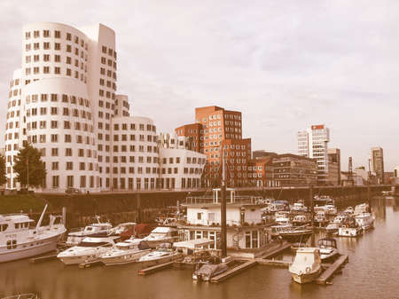 architecture alphabet: DUESSELDORF, GERMANY - AUGUST 3, 2009: The new Medienafen is a redevelopment area in the former docklands and harbour with buildings designed by Steven Holl, David Chipperfield and Frank O Gehry vintage Editorial