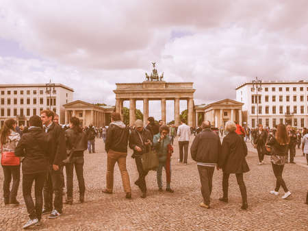 west germany: BERLIN, GERMANY - MAY 10, 2014: Tourists visiting the Brandenburger Tor (Brandenburg Gate) linking East and West Berlin vintage Editorial
