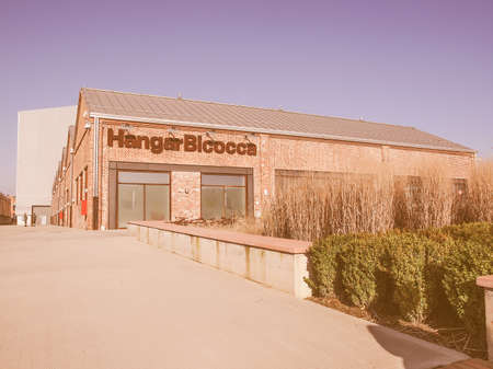 regeneration: MILAN, ITALY - FEBRUARY 23, 2014: The Hangar Bicocca is a new exhibition room for contemporary art built in 2004 into an abandoned factory in a large regeneration area vintage Editorial