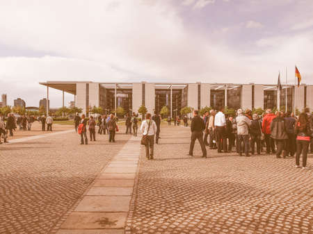 bundes: BERLIN, GERMANY - MAY 09, 2014: People visiting the Band des Bundes complex of government buildings near the Reichstag (German parliament) build in 1995 following the reunification of Germany vintage