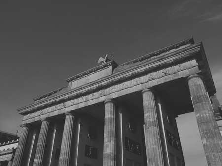 brandenburger tor: Brandenburger Tor Brandenburg Gate famous landmark in Berlin Germany - faded vintage black and white effect Stock Photo