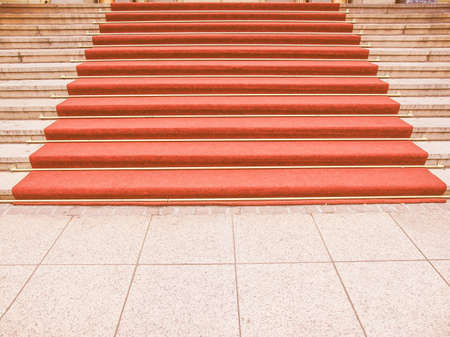 occasions: Red carpet on a stairway used to mark the route taken by heads of state, vips and celebrities on ceremonial and formal occasions or events vintage
