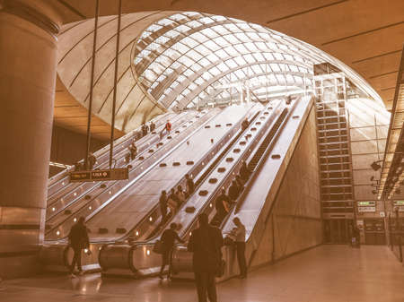 largest: LONDON, UK - SEPTEMBER 29, 2015: The Canary Wharf tube station serves the largest business district in the United Kingdom vintage
