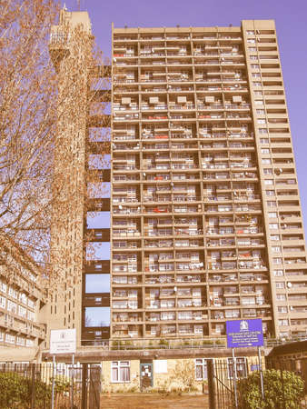 kensington: LONDON, ENGLAND, UK - MARCH 05, 2009: The Trellick Tower in North Kensington designed by Erno Goldfinger in 1964 is a Grade II listed masterpiece of new brutalist architecture vintage