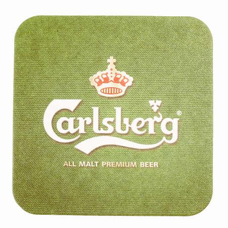 carlsberg: AMSTERDAM, DENMARK - MARCH 15, 2015: Beermat of Danish beer Carlsberg isolated over white background vintage Editorial