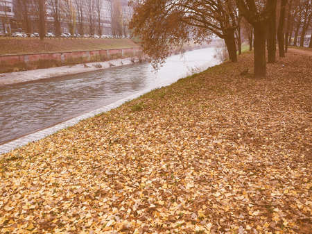 Banks of Dora Riparia river in winter in Regio Parco (meaning Royal Park) quarter in Turin, Italy vintage