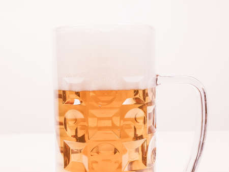 bier: A large glass of German lager beer vintage Stock Photo