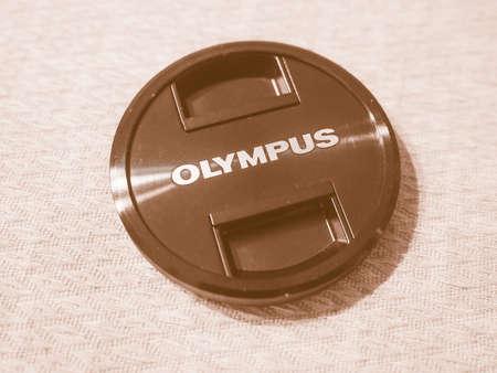 olympus: TOKYO, JAPAN - CIRCA AUGUST 2015:  Olympus logo on camera lens cap vintage