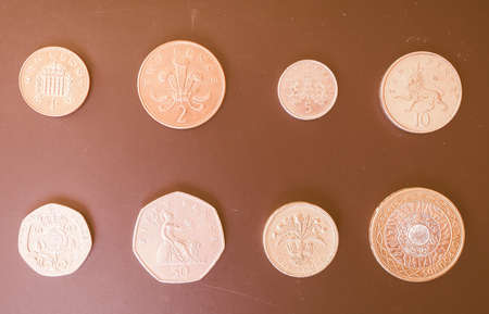 money pound: British Pounds coins of the United Kingdom vintage Stock Photo