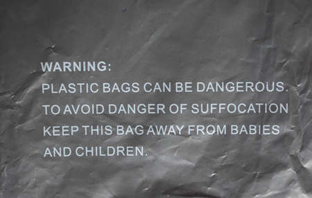 suffocation: Danger of suffocation warning sign on a plastic bag Stock Photo