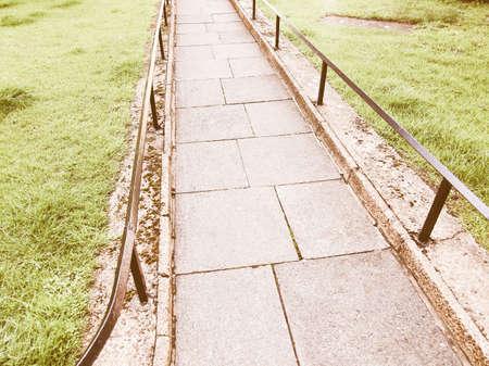 pedestrians: A concrete pavement sidewalk path for pedestrians vintage