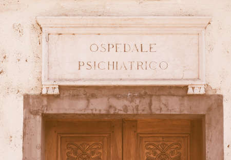 talian: Ospedale Psichiatrico ancient talian sign meaning Mental Hospital vintage Stock Photo