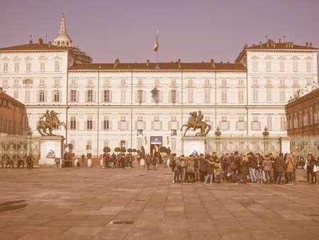 castello: TURIN, ITALY - FEBRUARY 19, 2015: Tourists visiting Piazza Castello central baroque square vintage Editorial